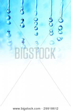 macro of water droplets (falling rain effect); winter theme