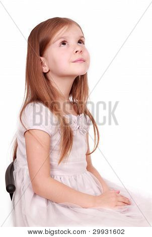 little girl is looking up