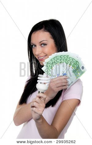 woman with energy-saving lamp. lamp energy and money â?¬
