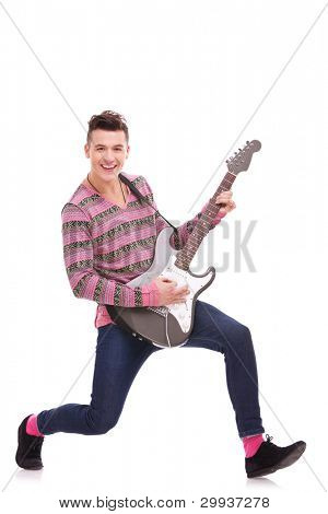 Guitar man. Guitarist Playing six-string electric guitar. white background. rock and roll image of a casual young man playing his electric guitar and smiling to the camera