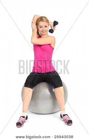 Young woman doing Seated Dumbbell One Arm Triceps Extensions on Fitnes Ball, phase 1 of 2.
