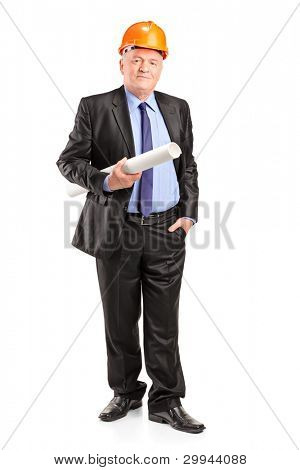 Full length portrait of a mature construction worker with helmet holding blueprints isolated on white background