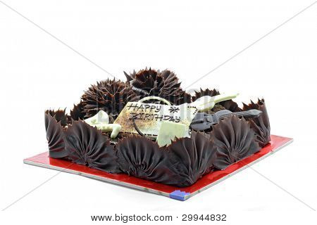Whole Dark and Sweet Chocolate Happy Bitrthday Cake Dessert isolated on White Background.