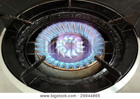 LPG Gas Burner hot blue fire flames from a stove for cooking in a kitchen