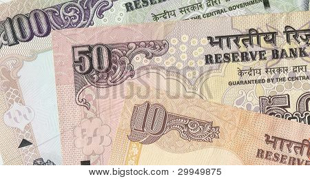 Fragment of Indian banknotes - 10, 50 and 100 Indian rupees, the sample in 2010, the front side.