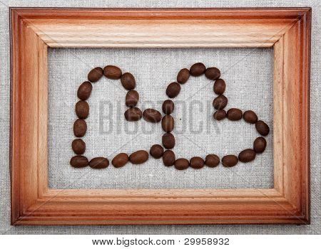 Two Hearts Of Coffee Beans In Frame.