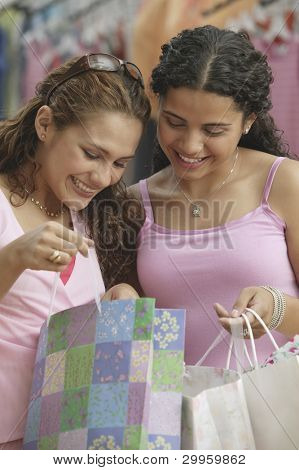 Young woman looking in shopping bags