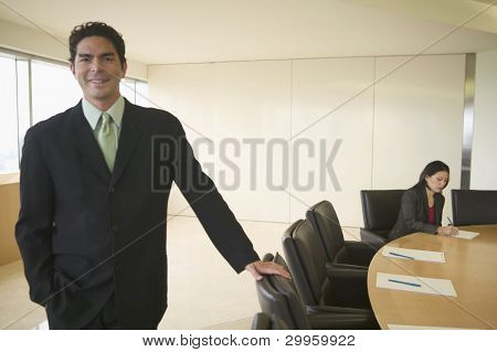 Businessman posing in conference room