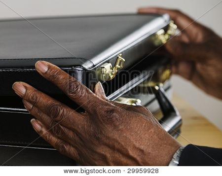 Businessman opening briefcase