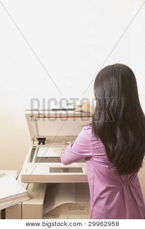 Woman at photocopy machine