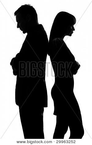 one caucasian couple standing back to back man and woman sad in studio silhouette isolated on white background