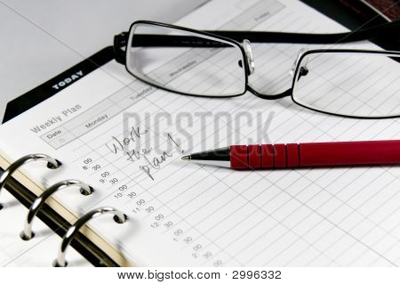 Business Diary With Spectacles And Pen