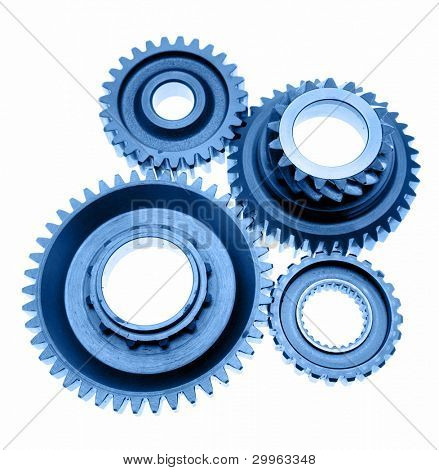 Four cogs connecting over white