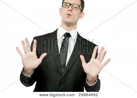 """Young handsome businessman in black suit making """"stop"""" gesture."""