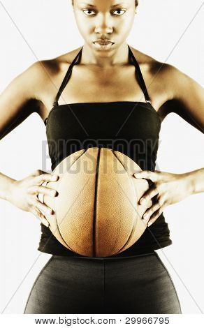 Portrait of woman holding basketball