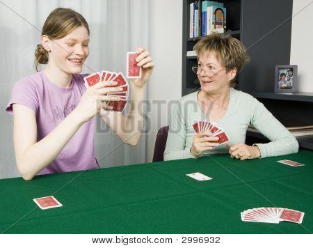 Girl And Grandma Playing Cards