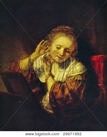 USSR - CIRCA 1981: Postcard shows draw by Rembrandt van Rijn - Young Woman with Earrings, Hermitage, St. Petersburg circa 1981