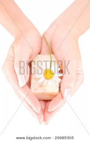 Woman's hands holding a bar of soap isolated on white background