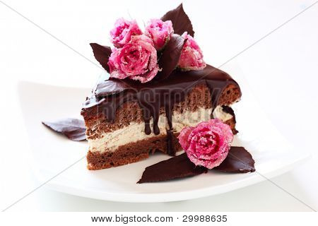 piece of chocolate cake on white isolated background