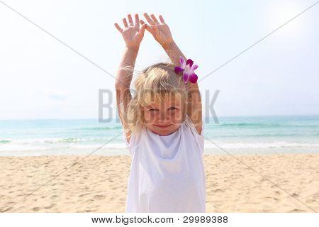 Beautiful little girl on  beach