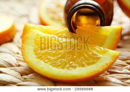 bottle of oranges essential oil - beauty treatment