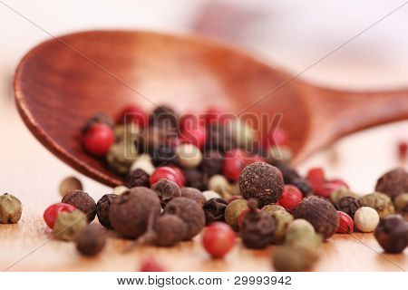 Wooden spoon with pepper, close up