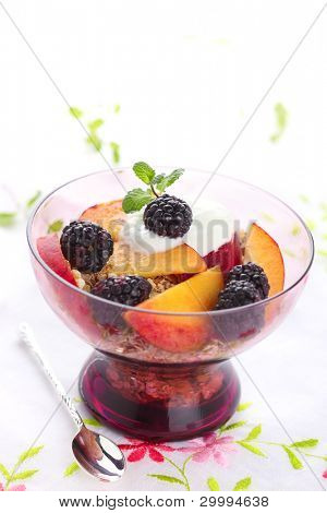 healthy breakfast -muesli with fresh berries, fruit and yogurt
