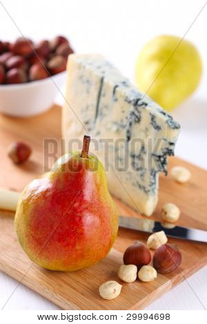 Lifestyle -pear, blue cheese and walnuts on wooden board