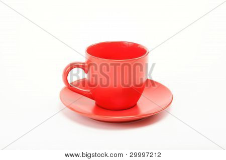 Cup And Saucer Are On White
