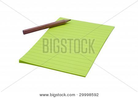 Yellow lined paper and pencil on isolated white background