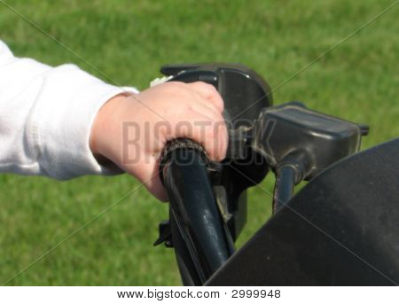 Baby'S Hand On 4-Wheeler Controls