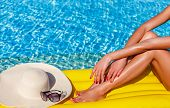 Portrait Of Sexy Tanned Slim Model Woman In Colorful Bikini And Hat Having Relax And Enjoying In Swi poster