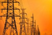 High Voltage Electric Pole And Transmission Lines In The Evening. Electricity Pylons At Sunset. Powe poster