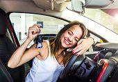 Young Pretty Woman Happy And Smiling, Holding The Keys Of The White Car, Confident, Offering Them To poster