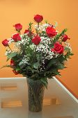 picture of one dozen roses  - dozen of red roses in a vase on the table - JPG