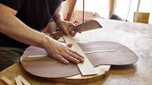 Marking And Pasting Brace To The Soundboard Of A Classical Guitar. Production Of Classical Guitar. poster