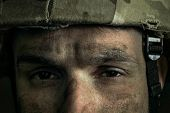 Eyes Full Of Pain And Confusion. Close Up Portrait Of Young Male Soldier. Man In Military Uniform On poster