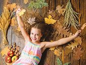 Kid Girl Smiling Face Relax Wooden Background Autumn Attributes Top View. Child With Long Hair With  poster