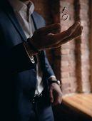 Groom Throws Up Wedding Rings. Groom Throws Rings By Hand poster