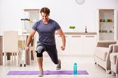 Man exercising for knee injury recovery poster