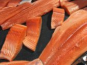 Sliced Raw Salmon Or Fresh Salmon. Salmon Fillets For Sale At Market Displayed With A Patchwork Effe poster