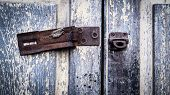 Vintage Rustic Stain Old Lock Stain U Line Hasp Hardened Staple Equipment On Painted Wooden Door. Ol poster