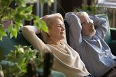 Peaceful Middle Aged Man And Woman Relaxing On Comfortable Couch poster