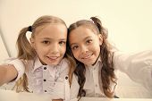 Happy Children Back To School And Making Selfie. Selfie Of Happy Children In School Uniform. Cheerfu poster