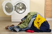Pile Of Dirty Laundry Near Washing Machine Indoors poster