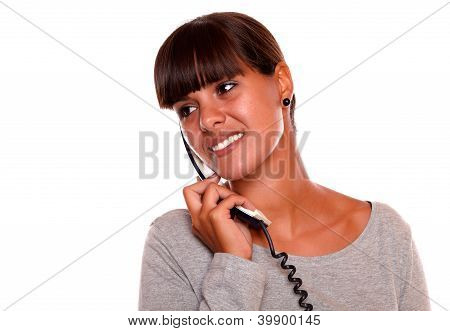 Young Woman Conversing On Phone Looking To Right