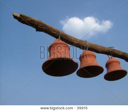 Clay Bells Hanging From A Pole