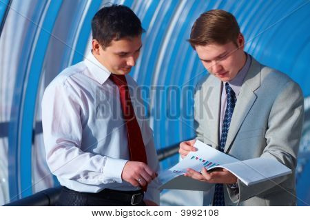 Two Business Men Is Watching Report