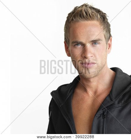 Young attractive healthy man against white background with copy space