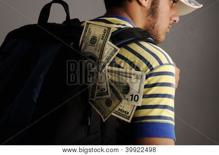 Young arabic man with backpack filled with money